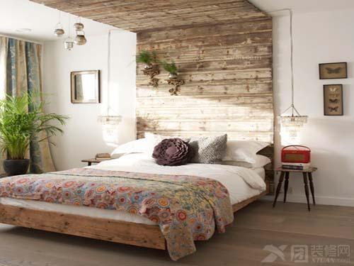 森式风格的卧室利用实木装饰了凉面墙,独特的设计感把床融入在自然