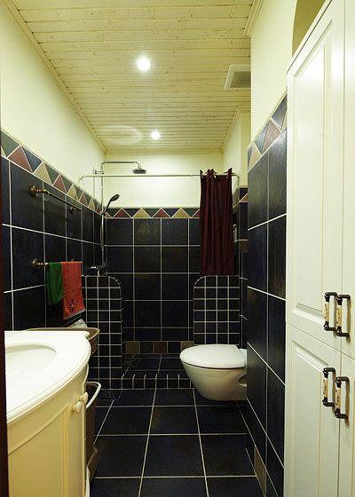 卫生间的黑色瓷砖装修效果图